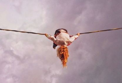 photo of woman suspended on rope
